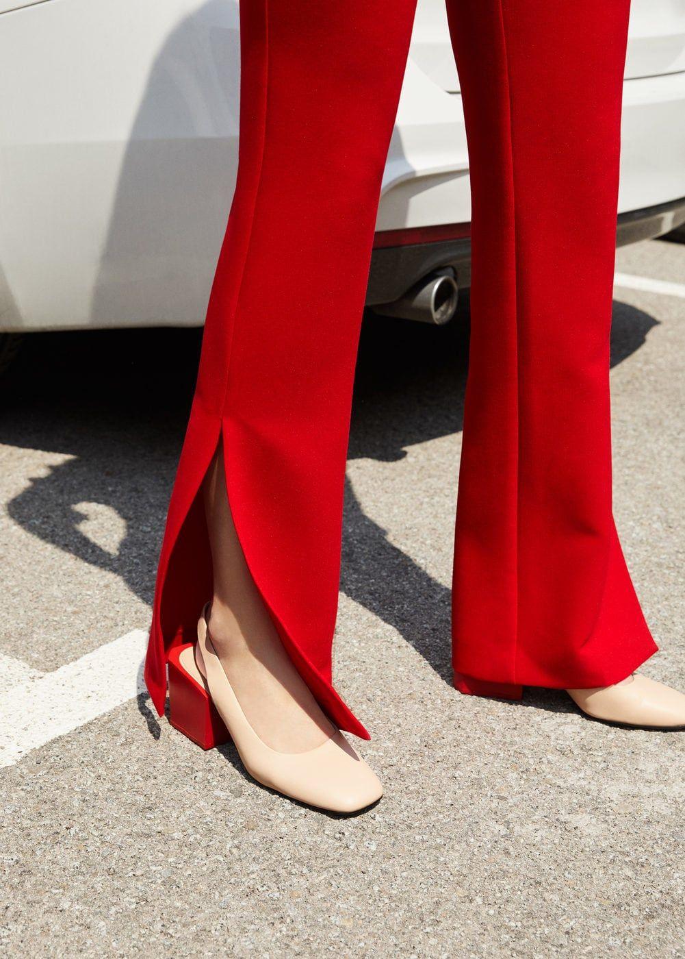 красные брюки с разрезами